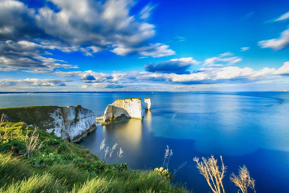 "<p>Famed for its fossil foraging and craggy cliff faces, the spectacular Jurassic Coast runs 95 miles from Exmouth in Devon to Old Harry Rocks near Swanage in Dorset. A coastal escape here is the perfect way to visit charming villages and rock formations that you can see by train and boat.</p><p>The Swanage Railway is a highlight for its full-size steam and diesel passenger trains that run along the five and a half mile line. It's the perfect way to see Dorset, taking you from Norden to Corfe Castle and down to the seaside town of Swanage.</p><p><a class=""link rapid-noclick-resp"" href=""https://www.goodhousekeepingholidays.com/tours/jurassic-coast-bournemouth-hampshire-rail"" rel=""nofollow noopener"" target=""_blank"" data-ylk=""slk:BOOK A TRIP"">BOOK A TRIP</a></p>"
