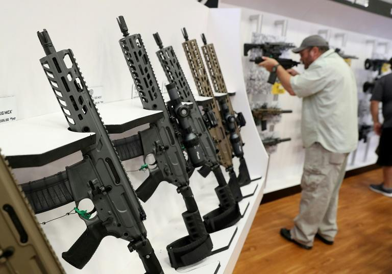Sig Sauer rifles are displayed during the National Rifle Association convention on May 5, 2018 in Dallas, Texas