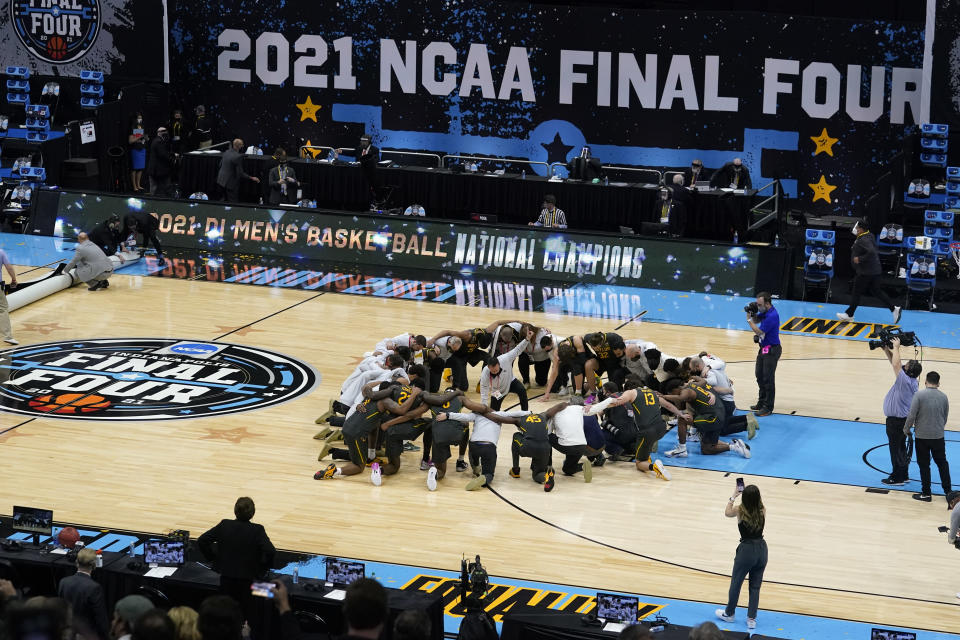 FILE - Baylor players huddle on the court at the end of the championship game against Gonzaga in the men's Final Four NCAA college basketball tournament in Indianapolis, in this Monday, April 5, 2021, file photo. A law firm hired to investigate gender equity concerns at NCAA championship events released a blistering report Tuesday, Aug. 3, 2021, that recommended holding the men's and women's Final Fours at the same site and offering financial incentives to schools to improve their women's basketball programs. (AP Photo/Darron Cummings, File)