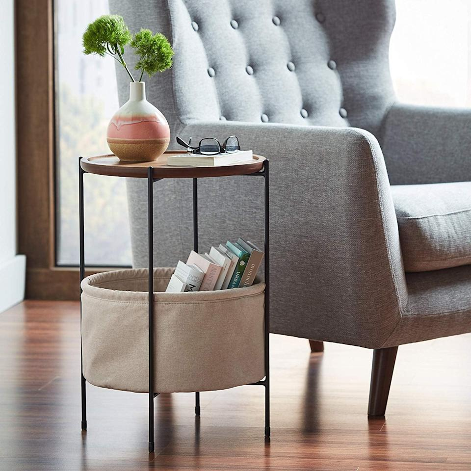 <p>This <span>Rivet Round Storage Basket Side Table</span> ($128) comes in a couple different colors.</p>