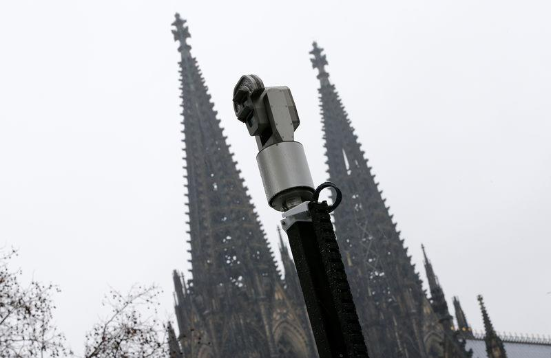 """FILE PHOTO: Surveillance cameras are pictured in front of Cologne Cathedral during """"Weiberfastnacht"""" carnival celebration in Cologne"""