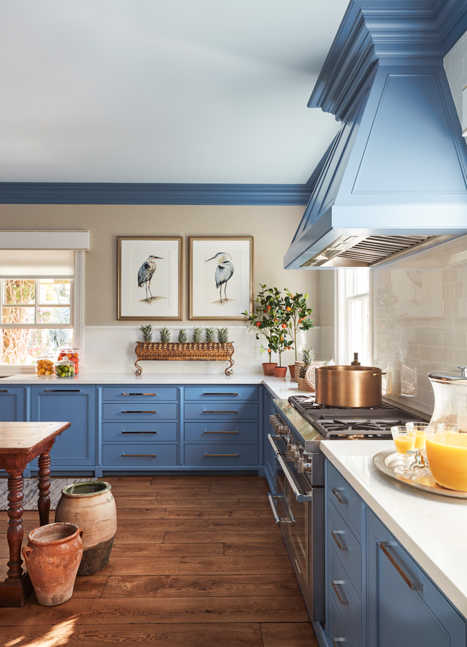 """<p>This blue may not be of this earth, but it is the color of the sky and the ocean, and is nonetheless comforting to the soul. Connecticut designer <a href=""""http://sarahblankdesignstudio.com/"""" rel=""""nofollow noopener"""" target=""""_blank"""" data-ylk=""""slk:Sarah Blank"""" class=""""link rapid-noclick-resp"""">Sarah Blank</a> creatively inverts the traditional use of colors and paints the cabinets an ethereal Blue Dragon by Benjamin Moore while leaving the walls neutral with <a href=""""https://www.carlisleco.com/"""" rel=""""nofollow noopener"""" target=""""_blank"""" data-ylk=""""slk:Carlisle and Co."""" class=""""link rapid-noclick-resp"""">Carlisle and Co.</a> linen wallpaper at the <a href=""""https://www.veranda.com/decorating-ideas/a30641052/kips-bay-decorator-show-house-palm-beach-2020/"""" rel=""""nofollow noopener"""" target=""""_blank"""" data-ylk=""""slk:Kips Bay 2020 Show"""" class=""""link rapid-noclick-resp"""">Kips Bay 2020 Show</a> house in Palm Beach.</p><p><a class=""""link rapid-noclick-resp"""" href=""""https://www.benjaminmoore.com/en-us/color-overview/find-your-color/color/810/blue-dragon?color=810"""" rel=""""nofollow noopener"""" target=""""_blank"""" data-ylk=""""slk:Get the Look"""">Get the Look</a></p>"""