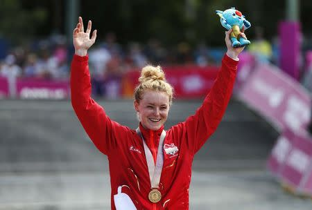 Cycling Cross-Country - Gold Coast 2018 Commonwealth Games - Mountain Bike - Women's Cross-Country - Nerang Mountain Bike Trails - Gold Coast, Australia - April 12, 2018. Annie Last of England poses with her gold medal. REUTERS/Paul Childs
