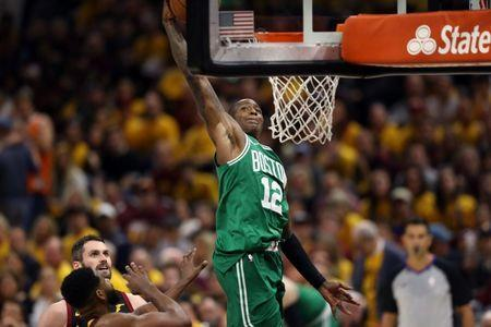 May 19, 2018; Cleveland, OH, USA; Boston Celtics guard Terry Rozier (12) attempts a basket against the Cleveland Cavaliers during the third quarter in game three of the Eastern conference finals of the 2018 NBA Playoffs at Quicken Loans Arena. Mandatory Credit: Aaron Doster-USA TODAY Sports
