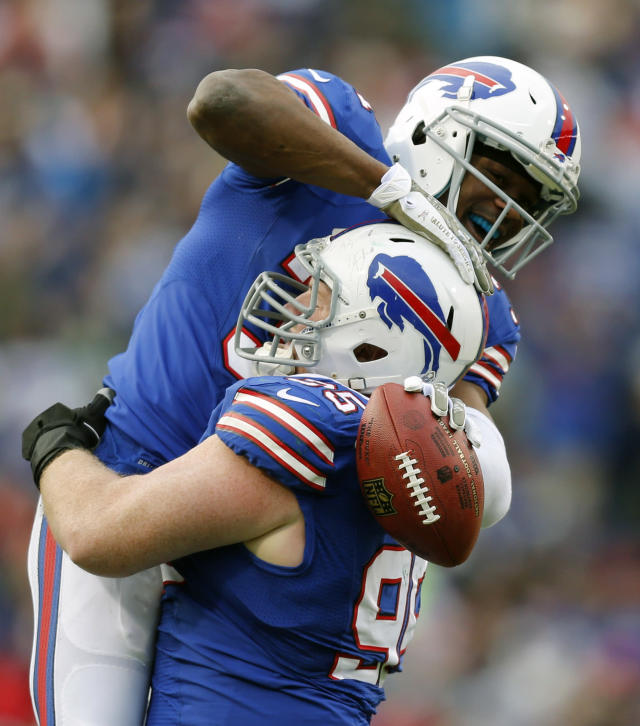 Buffalo Bills free safety Jairus Byrd celebrates an interception with teammate Kyle Williams during the second half of an NFL football game against the New York Jets on Sunday, Nov. 17, 2013, in Orchard Park, N.Y. (AP Photo/Gary Wiepert)