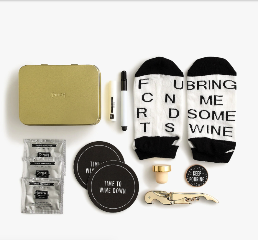 """<h2>Pinch Provisions Wine Night Kit</h2> <br>This cute little curated kit contains a collection of wine-centric accessories — including glass markers, coasters, stain removing spray, """"If you can read this, bring me some wine"""" socks, a sip-decision game coin, wine-removing towelettes, and a gold-tone stopper plus corkscrew. <br><br><em>Shop <strong><a href=""""https://www.jcrew.com/c/womens_category/brandswelove/brand-pinch-provisions"""" rel=""""nofollow noopener"""" target=""""_blank"""" data-ylk=""""slk:Pinch Provisions"""" class=""""link rapid-noclick-resp"""">Pinch Provisions</a></strong></em><br><br><strong>Pinch Provisions</strong> Wine Night Kit, $, available at <a href=""""https://go.skimresources.com/?id=30283X879131&url=https%3A%2F%2Fwww.jcrew.com%2Fus%2Fp%2Fwomens_category%2Fall_accessories%2Fgifts%2Fpinch-provisions-wine-night-kit%2FK4913"""" rel=""""nofollow noopener"""" target=""""_blank"""" data-ylk=""""slk:J. Crew"""" class=""""link rapid-noclick-resp"""">J. Crew</a><br><br><br>"""