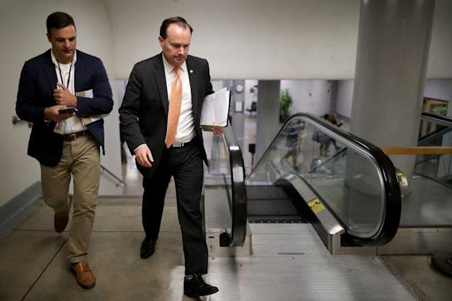 Sen. Mike Lee (R-UT) (2nd L) heads for his party's weekly policy luncheon at the U.S. Capitol May 16, 2017 in Washington. Many Republican and Democratic senators expressed frustration and concern about how President Donald Trump may have shared classified intelligence with the Russian foreign minister last week at the White House. (Photo: Chip Somodevilla/Getty Images)