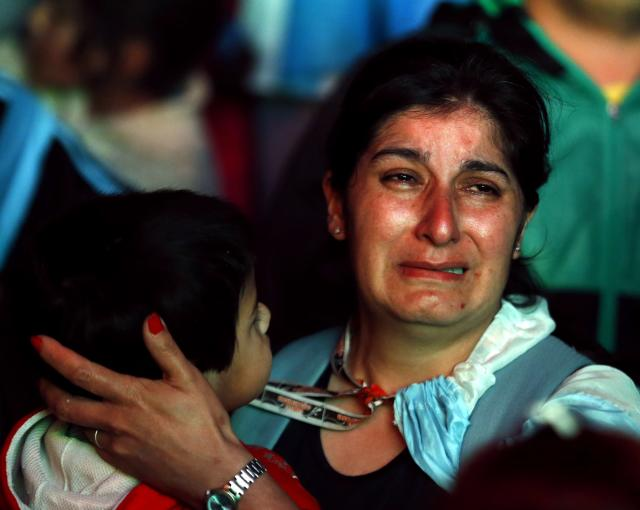 An Argentina fan reacts after Argentina lost to Germany in their 2014 World Cup final soccer match in Brazil, at a public square viewing area in Buenos Aires, July 13, 2014. REUTERS/Ivan Alvarado (ARGENTINA - Tags: SPORT SOCCER WORLD CUP)