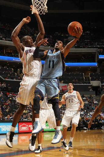 CHARLOTTE, NC - APRIL 20: Mike Conley #11 of the Memphis Grizzlies shoots against Bismack Biyombo #0 of the Charlotte Bobcats at the Time Warner Cable Arena on April 20, 2012 in Charlotte, North Carolina. (Photo by Kent Smith/NBAE via Getty Images)