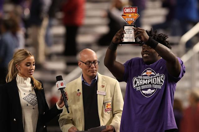 "TCU running back <a class=""link rapid-noclick-resp"" href=""/ncaaf/players/264345/"" data-ylk=""slk:Sewo Olonilua"">Sewo Olonilua</a> was the offensive MVP of the Cheez-It Bowl. (Photo by Christian Petersen/Getty Images)"