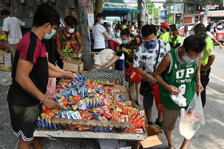 Community-run stalls offer free food to Filipinos struggling to feed their families as virus lockdowns have thrown thousands out of work