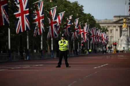 A policeman stands in the Mall decked out with Union Jack flags