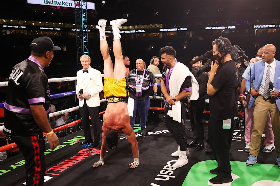 Logan Paul does a hand stand after his contracted exhibition boxing match against Floyd Mayweather
