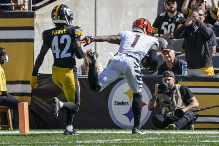 Cincinnati Bengals wide receiver Ja'Marr Chase (1) makes a catch past Pittsburgh Steelers cornerback James Pierre (42) and takes the ball in for a touchdown during the first half an NFL football game, Sunday, Sept. 26, 2021, in Pittsburgh. (AP Photo/Gene J. Puskar)