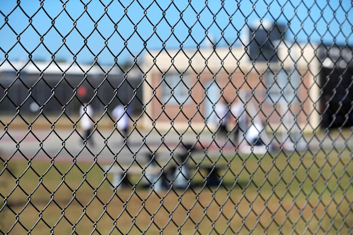 In this Sept. 26, 2019, file photo, detainees sit in a yard during a media tour inside the Winn Correctional Center in Winnfield. (Photo: ASSOCIATED PRESS)