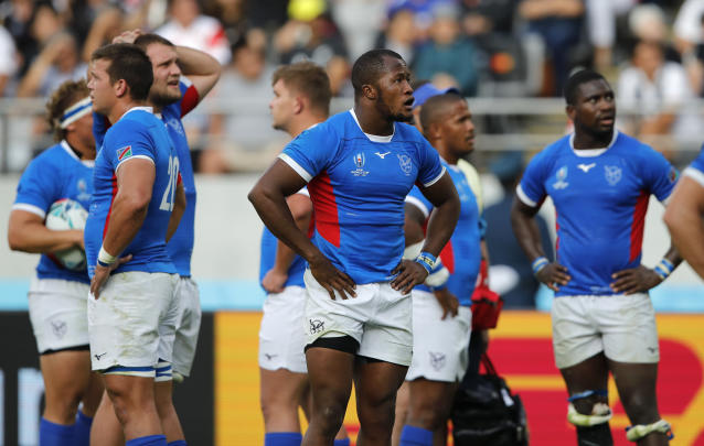 Namibian players react during the Rugby World Cup Pool B game at Tokyo Stadium between New Zealand and Namibia in Tokyo, Japan, Sunday, Oct. 6, 2019. The All Blacks defeated Namibia 71-9. (AP Photo/Christophe Ena)