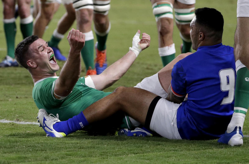 Ireland's Johnny Sexton celebrates after scoring a try during the Rugby World Cup Pool A game at Fukuoka Hakatanomori Stadium between Ireland and Samoa, in Fukuoka, Japan, Saturday, Oct. 12, 2019. (AP Photo/Aaron Favila)
