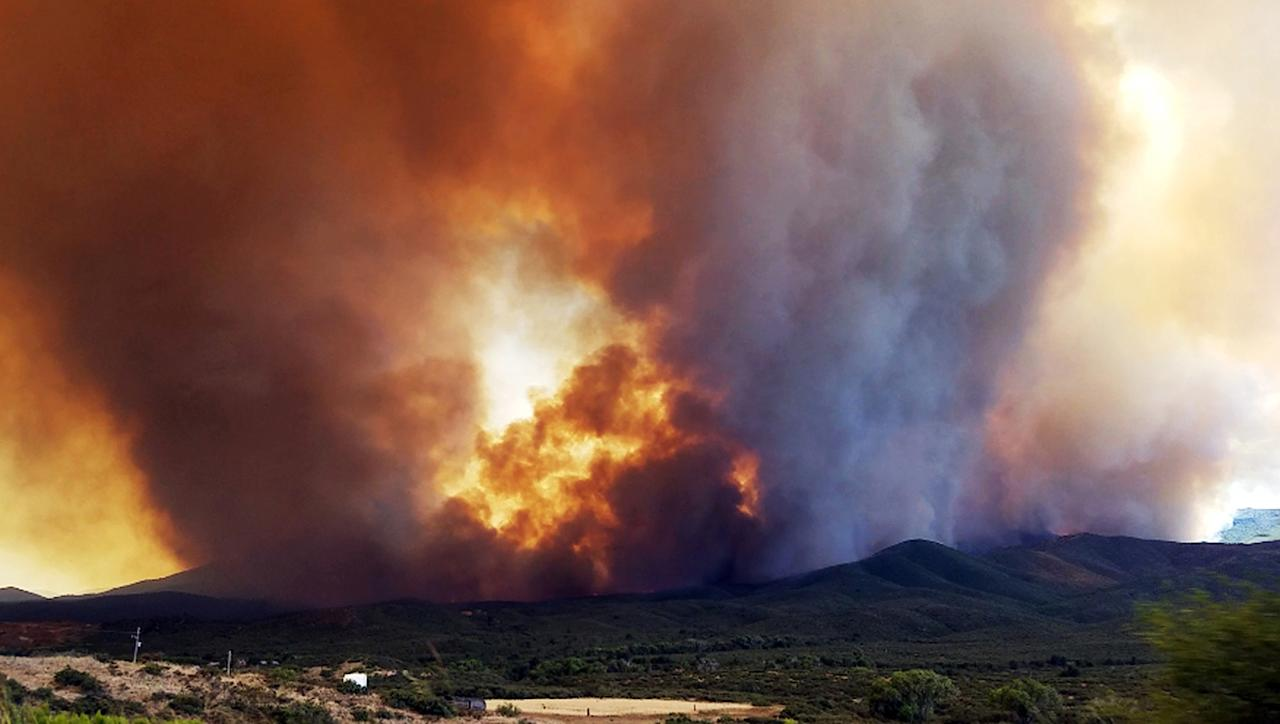 <p>In this Tuesday, June 27, 2017 frame from video, flames and smoke rise from a fire near Mayer, Ariz. The Arizona fire forced the evacuation of Mayer along with several other mountain communities in the area. (Jennifer Johnson via AP) </p>