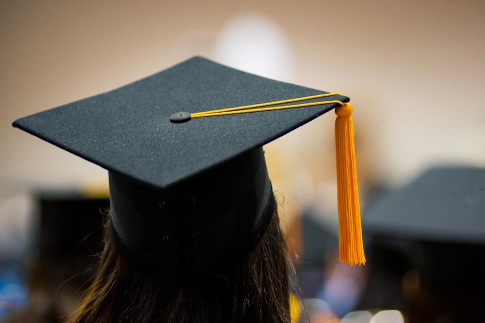 Rear View Of Woman Wearing Mortarboard