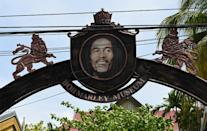 A sign showing Jamaican reggae legend Bob Marley at the entrance to the Bob Marley Museum in Kingston, Jamaica, on May 17, 2019