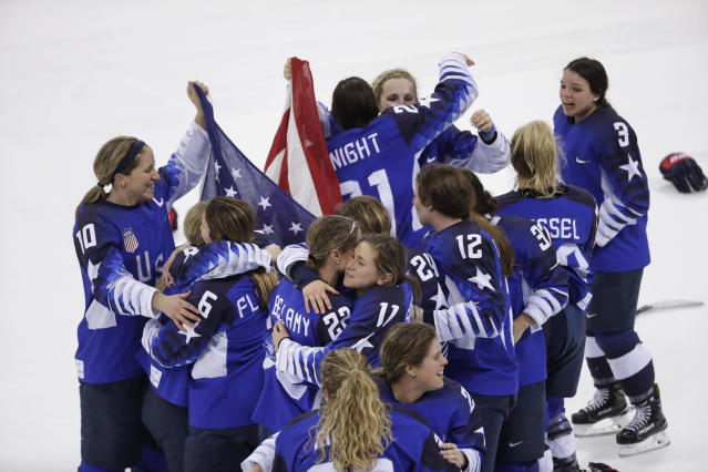 <p>United States celebrates winning gold after the women's gold medal hockey game against Canada at the 2018 Winter Olympics in Gangneung, South Korea, Thursday, Feb. 22, 2018. (AP Photo/Matt Slocum) </p>