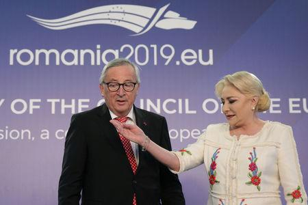 Romanian Prime Minister Viorica Dancila welcomes European Commission President Jean-Claude Juncker in Bucharest, Romania, January 11, 2019. Inquam Photos/Octav Ganea via REUTERS ATTENTION EDITORS - THIS IMAGE WAS PROVIDED BY A THIRD PARTY. ROMANIA OUT.