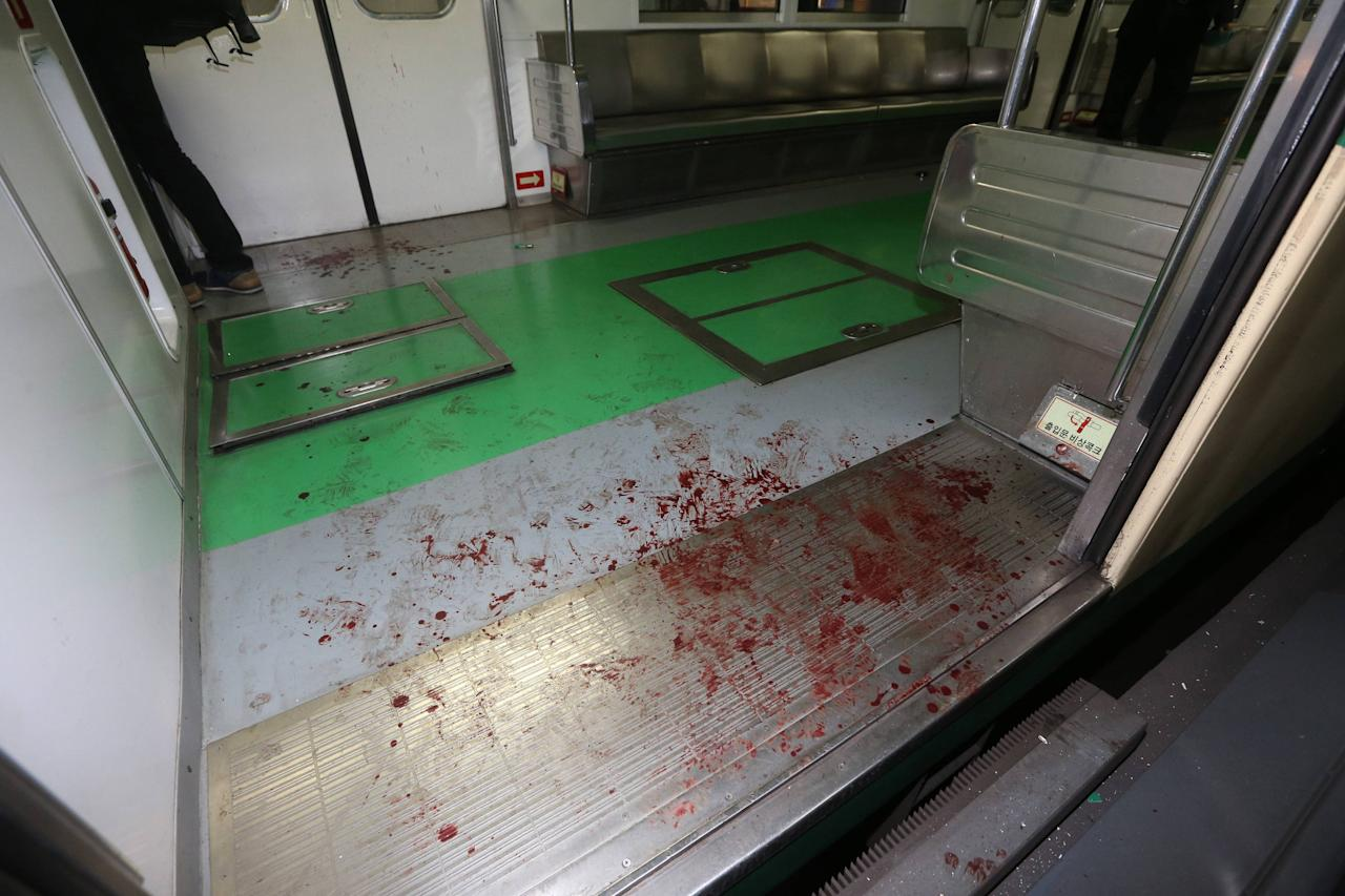 Blood marks are seen on the floor of a damaged subway train at a subway station in Seoul May 2, 2014. Two subway trains collided on Friday at a station in the South Korean capital Seoul, injuring 78 passengers, the emergency services said, although none appeared to be seriously hurt. REUTERS/Park Dong-ju/Yonhap (SOUTH KOREA - Tags: TRANSPORT DISASTER) 