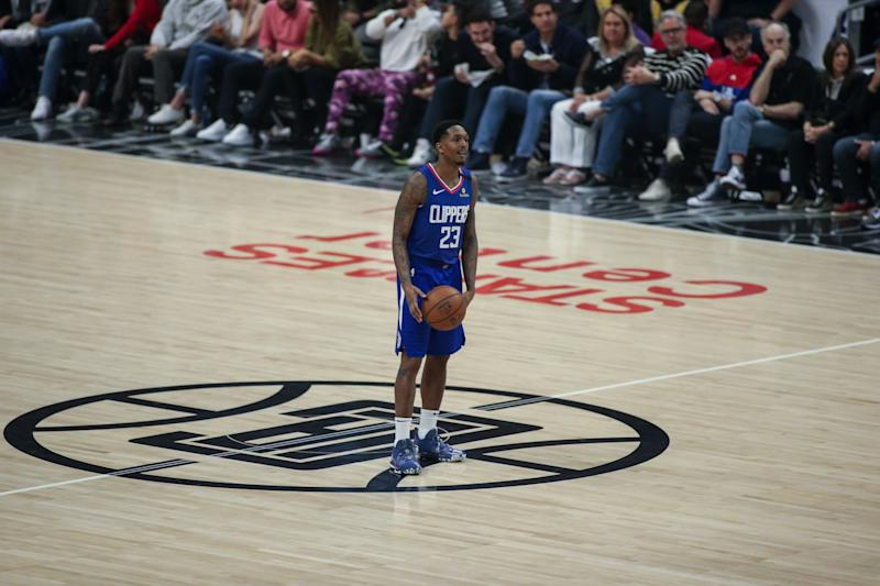LOS ANGELES, CA - MARCH 08: LA Clippers guard Lou Williams (23) sits at half court during the Los Angeles Lakers game versus the Los Angeles Clippers on Sunday March 8, 2020, at Staples Center in Los Angeles, CA. (Photo by Jevone Moore/Icon Sportswire via Getty Images)