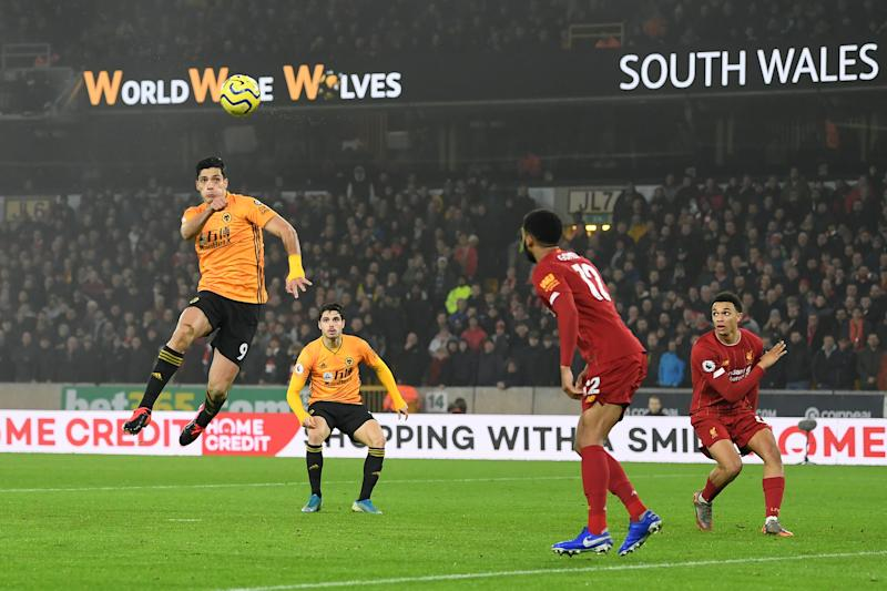 WOLVERHAMPTON, ENGLAND - JANUARY 23: Raul Jimenez of Wolverhampton Wanderers scores his team's first goal during the Premier League match between Wolverhampton Wanderers and Liverpool FC at Molineux on January 23, 2020 in Wolverhampton, United Kingdom. (Photo by Michael Regan/Getty Images)