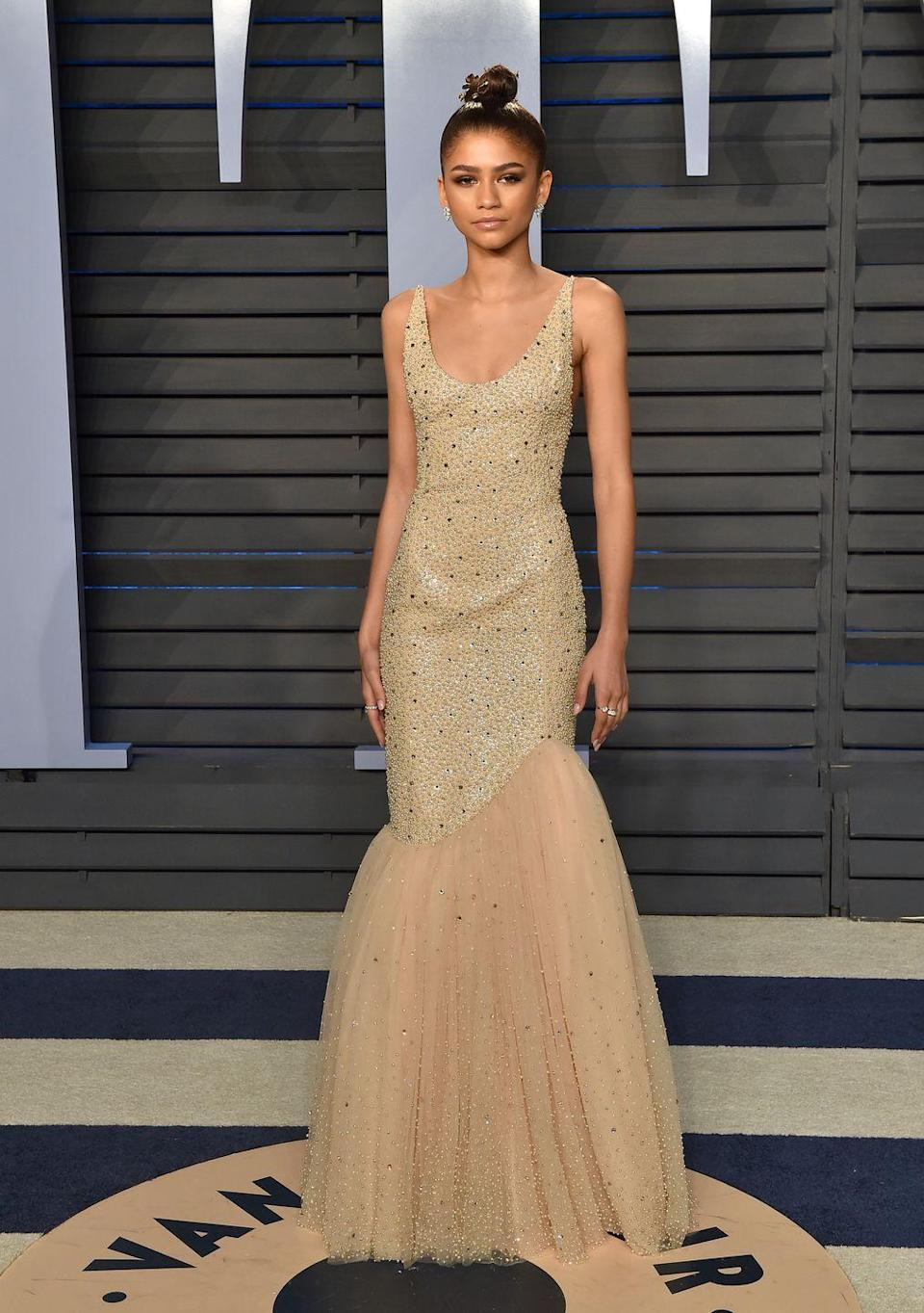 <p>At the 2018 <em>Vanity Fair</em> Oscar Party, she resembled a gold statue in this shimmery Michael Kors gown.</p>