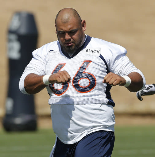 Denver Broncos center Manny Ramirez stretches during NFL football minicamp at the team's training facility in Englewood, Colo., Wednesday, June 11, 2014. (AP Photo/Ed Andrieski)