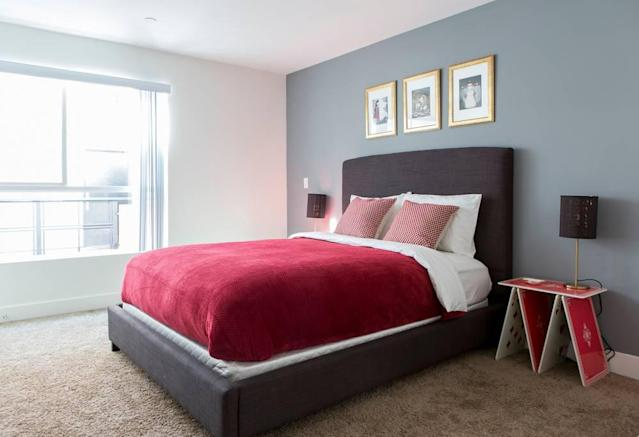 <p>There are three bedrooms in the home. The first is this Queen of Hearts suite, guarded by card soldiers at your bedside. (Airbnb) </p>
