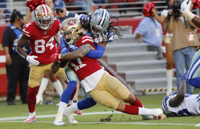 San Francisco 49ers wide receiver Jalen Hurd (17) scores against Dallas Cowboys cornerback Donovan Olumba during the first half of an NFL preseason football game in Santa Clara, Calif., Saturday, Aug. 10, 2019. (AP Photo/Josie Lepe)