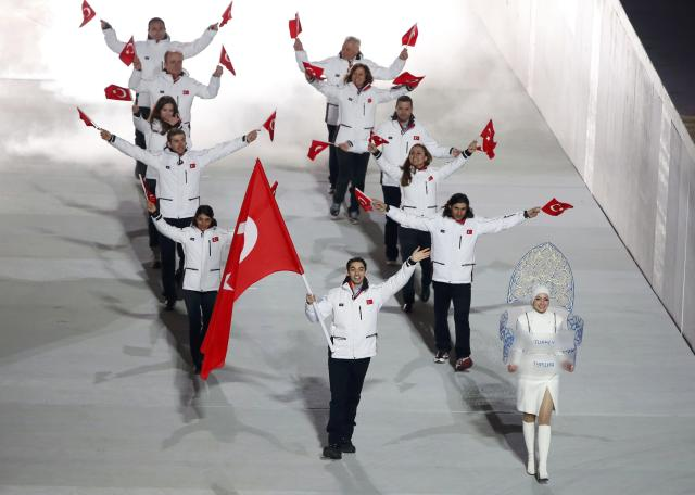 Turkey's flag-bearer Alper Ucar leads his country's contingent during the athletes' parade at the opening ceremony of the 2014 Sochi Winter Olympics, February 7, 2014. REUTERS/Lucy Nicholson (RUSSIA - Tags: OLYMPICS SPORT)