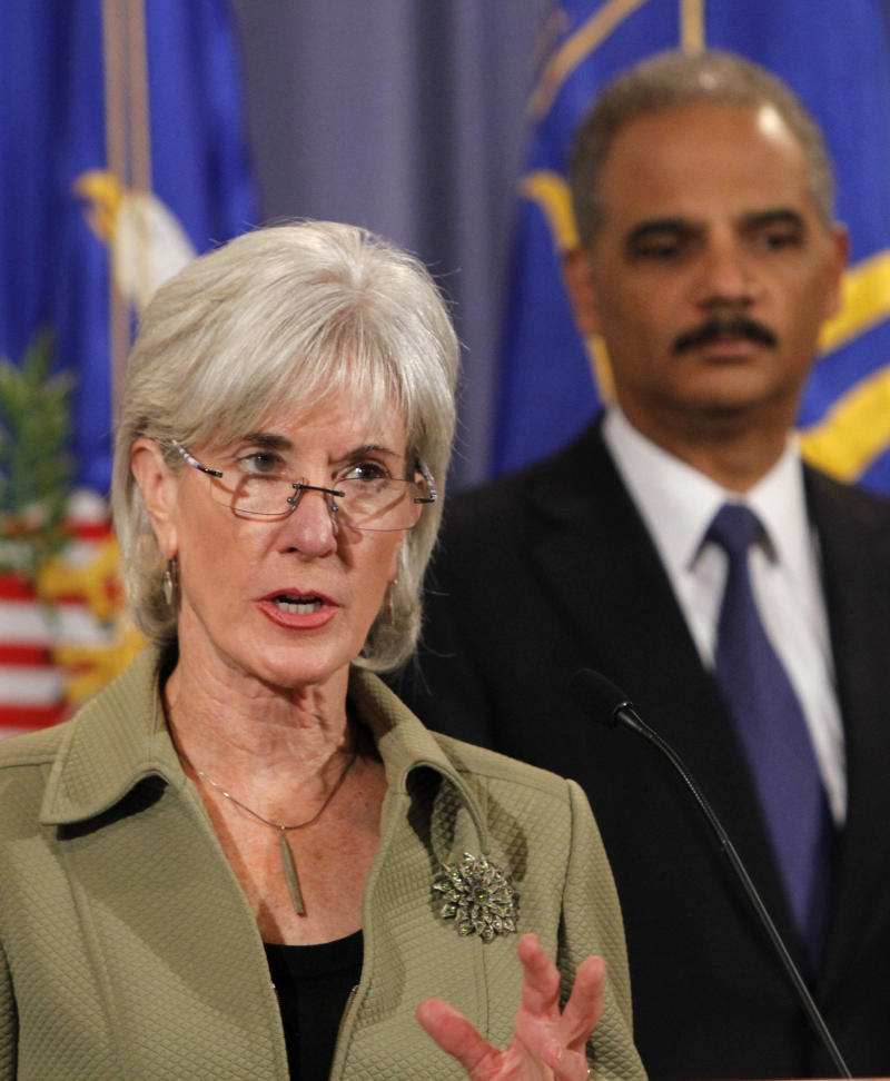 Department of Health and Human Services Secretary Kathleen Sebelius, left, speaks about the law enforcement actions of the Medicare fraud strike force as Attorney General Eric Holder listens at the Justice Department in Washington, Wednesday, Sept. 7, 2011.  A nationwide law enforcement crackdown has charged 91 people, including doctors and other medical professionals, with participating in Medicare fraud schemes involving $295 million in false billing.  (AP Photo/Jacquelyn Martin)