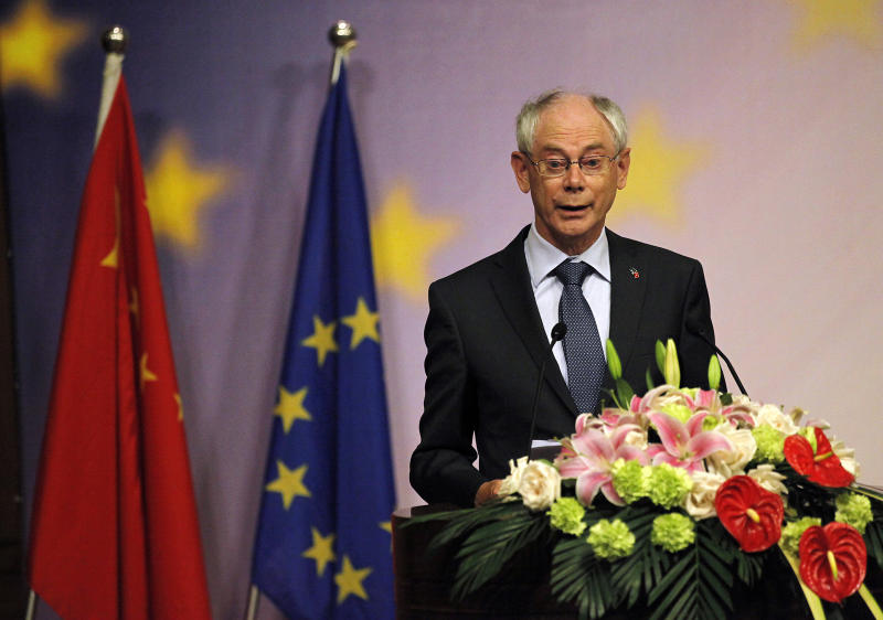 European Union President Herman Van Rompuy delivers a speech on trade and economic issues at CEIBS (China-Europe International Business School) on Wednesday, May 18, 2011 in Shanghai, China. The European Union's economic recovery is gaining momentum and the euro remains a strong, well trusted currency despite debt and deficit crises, the president of the 27-member block said Wednesday. (AP Photo/Eugene Hoshiko)