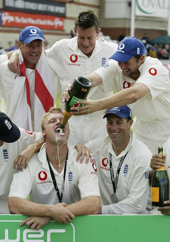 LONDON - SEPTEMBER 8:  Andrew Flintoff of England celebrates with his team-mates after England's victory over South Africa during the fifth day of the fifth npower test match between England and South Africa at The AMP Oval Cricket Ground on September 8, 2003 in London. (Photo by Clive Mason/Getty Images)
