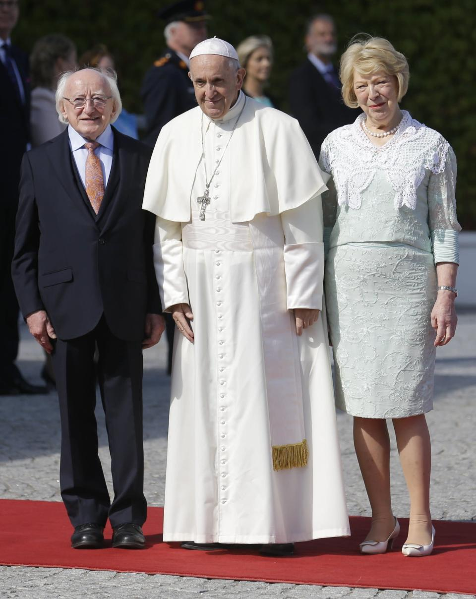 Pope Francis, center, is flanked by Irish President Michael D. Higgins, left, and President's wife Sabina at the Presidential residence in Dublin, Ireland, Saturday, Aug. 25, 2018. Pope Francis is on a two-day visit to Ireland. (AP Photo/Peter Morrison)