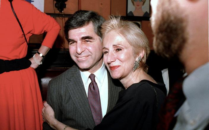 With her cousin, Michael, the governor of Massachusetts who unsuccessfully ran for president - AP