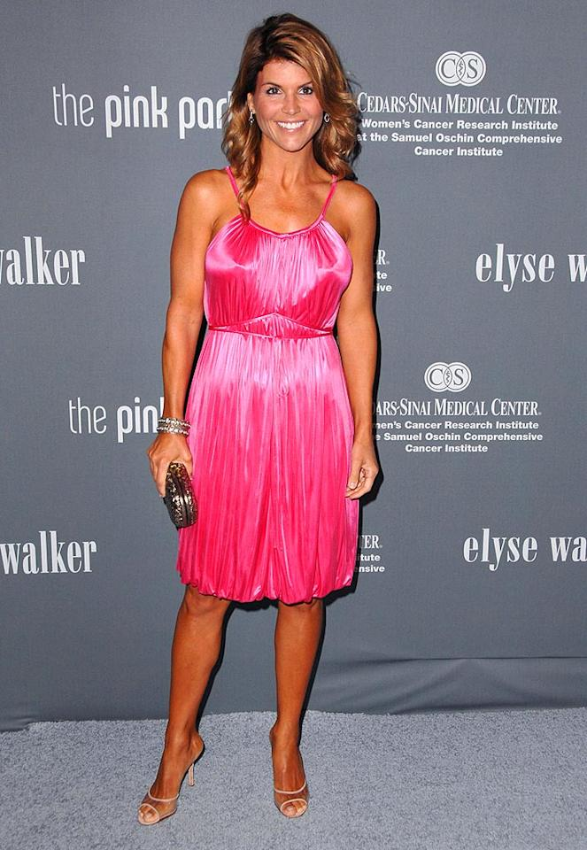 """90210"" star Lori Loughlin should turn the dial on her tanning bed down a notch or two! Steve Granitz/<a href=""http://www.wireimage.com"" target=""new"">WireImage.com</a> - September 13, 2008"