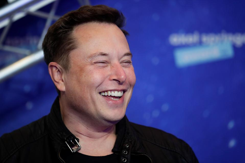 SpaceX owner and Tesla CEO Elon Musk laughs after arriving on the red carpet for the Axel Springer award, in Berlin, Germany, December 1, 2020. REUTERS/Hannibal Hanschke/Pool