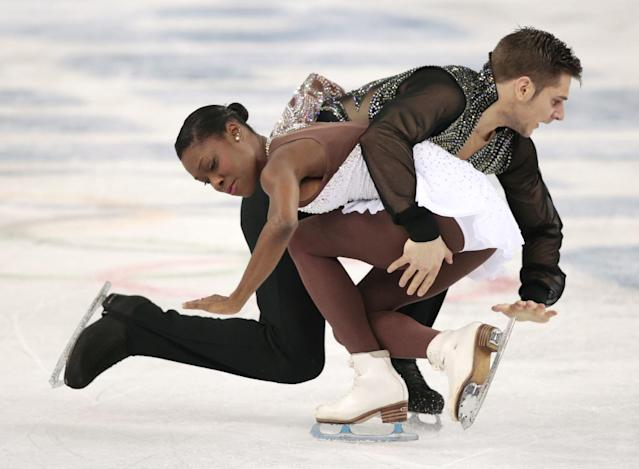 Vanessa James and Morgan Cipres of France compete in the pairs free skate figure skating competition at the Iceberg Skating Palace during the 2014 Winter Olympics, Wednesday, Feb. 12, 2014, in Sochi, Russia. (AP Photo/Ivan Sekretarev)
