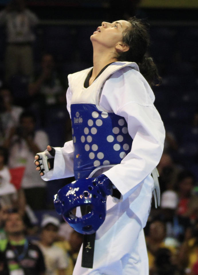 Mexico's Irma Contreras reacts after winning the gold medal at the end of the women's taekwondo -57 kg final match against Colombia's Doris Patino at the Pan American Games in Guadalajara, Mexico, Sunday, Oct. 16, 2011. (AP Photo/Martin Mejia)