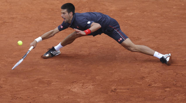 Novak Djokovic of Serbia returns in the mens final match against Rafael Nadal of Spain at the French Open tennis tournament in Roland Garros stadium in Paris, Sunday June 10, 2012. (AP Photo/David Vincent)