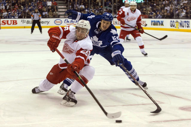 Detroit Red Wings Tomas Jurco, left, battles for the puck with Toronto Maple Leafs' Jerred Smithson during first period NHL hockey action in Toronto on Saturday, Dec 21, 2013. (AP Photo/The Canadian Press, Chris Young, File)