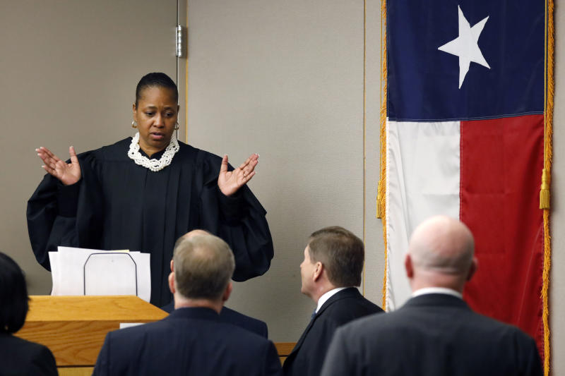 Judge Tammy Kemp meets with the attorneys at her bench upon their request during fired Dallas police officer Amber Guyger's murder trial, Wednesday, Sept. 25, 2019, in Dallas. Guyger is accused of shooting her unarmed black neighbor in his Dallas apartment.  (Tom Fox/The Dallas Morning News via AP, Pool)