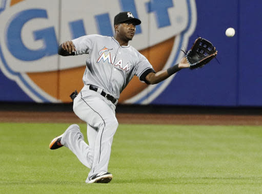 Miami Marlins center fielder Lewis Brinson runs to catch a ball hit by New York Mets' Luis Guillorme for an out during the fifth inning of a baseball game Monday, May 21, 2018, in New York. (AP Photo/Frank Franklin II)