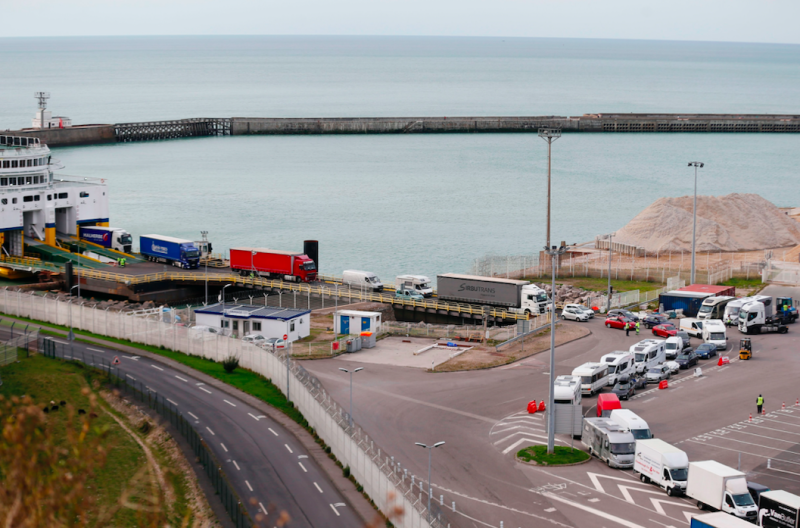 21 people found stowed inside truck at British port