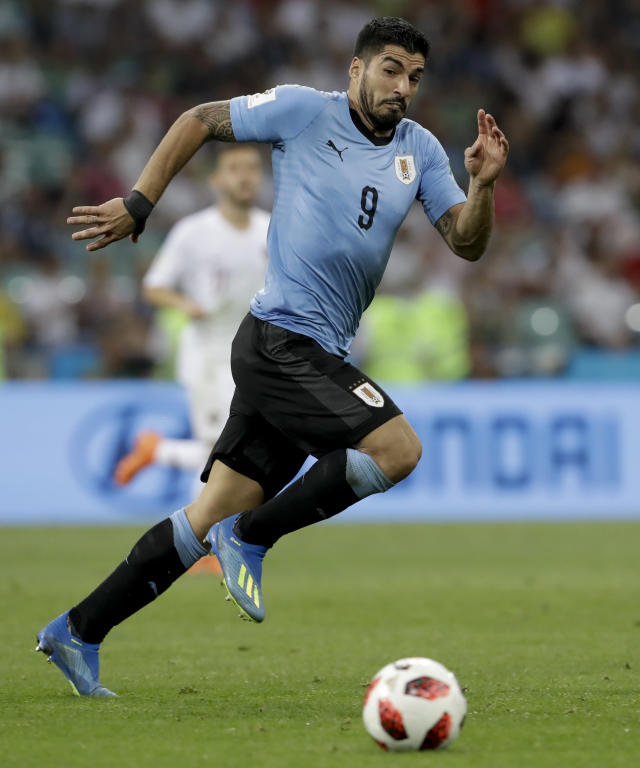 Uruguay's Luis Suarez views the ball during the round of 16 match between Uruguay and Portugal at the 2018 soccer World Cup at the Fisht Stadium in Sochi, Russia, Saturday, June 30, 2018. (AP Photo/Andre Penner)