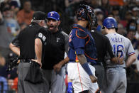 Texas Rangers manager Chris Woodward, second and from left, argues with home plate umpire Tim Timmons (95) after Brock Holt (16) and Woodward were ejected from the game for arguing a called third strike during the fourth inning of a baseball game against the Houston Astros, Sunday, July 25, 2021, in Houston. (AP Photo/Eric Christian Smith)